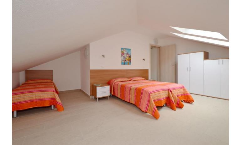 apartments FIORE: B4 - mansard roof bedroom (example)